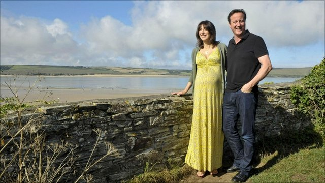 British Prime Minister David Cameron accompanied by his wife Samantha