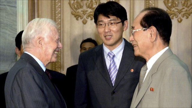 "Former U.S. President Jimmy Carter (L) shakes hands with Kim Yong-nam, president of the Presidium of the Supreme People""s Assembly of North Korea"