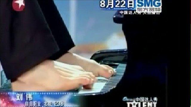 Liu Wei playing the piano