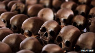 The skulls of Rwandan victims rest on shelves at a genocide memorial inside the church at Ntarama just outside the capital Kigali