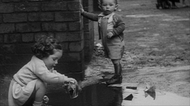 Black and white picture of toddlers playing