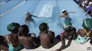 Black children in a swimming lesson