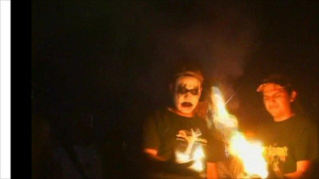 Revellers hold fire balls
