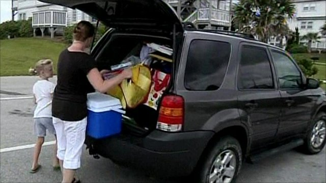 Family packing their car to evacuate