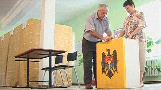 Electoral officials preparing a ballot box