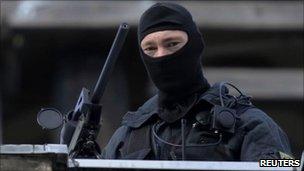 A police sniper near Sanssouci palace in Potsdam, 8 September 2010