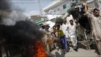 Men burn effigies of Pastor Terry Jones during protest, Multan, Pakistan, 10 September, 2010