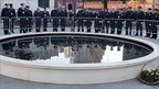 Police and fire officers by the reflecting pool in New York (11 Sept 2010)