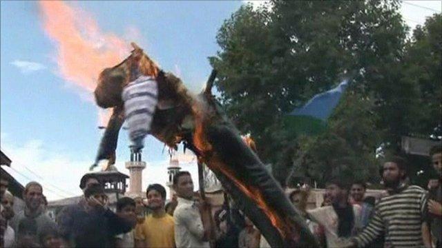 Protesters burning an effigy of President Barack Obama