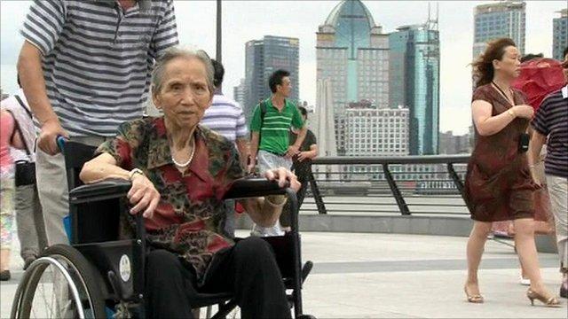 Elderly woman in wheelchair, Shanghai