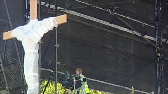 Cross on stage for open-air Mass