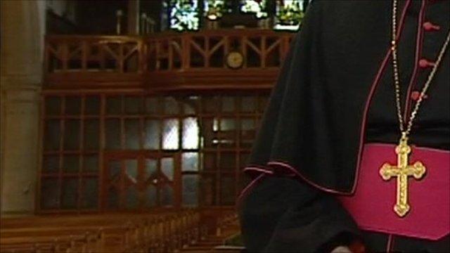 Catholic clergy wearing cross