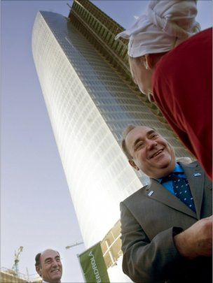 Scottish First Minister Alex Salmond (2R) talks to a Basque dancer next to President of Iberdrola power company Ignacio Galan (L) in front of the new Iberdrola Tower