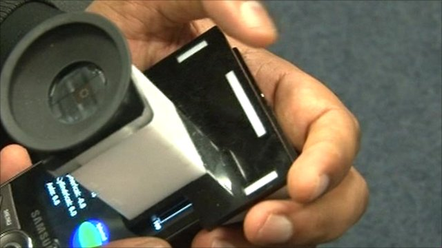 Snap-on camera lens attachjed to mobile phone