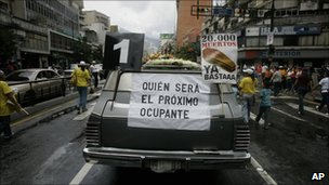 "A hearse with a poster that reads in Spanish ""Who will be the next occupant"" and ""20,000 deaths is enough"" during an opposition protest against violence in Caracas, in August"