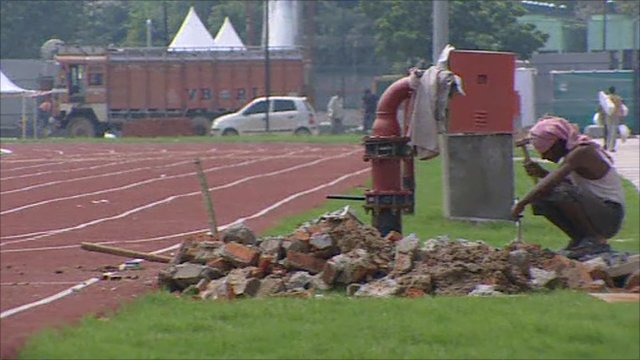 Worker finishing the athletics track