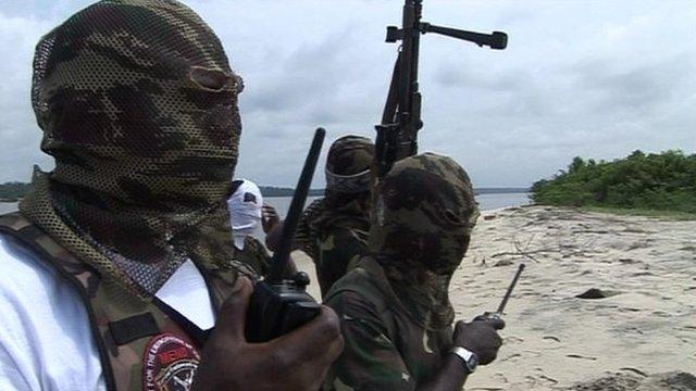 Hooded men on a beach