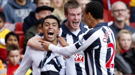 Gonzalo Jara (left) celebrates with Chris Brunt (centre) and Peter Odemwingie