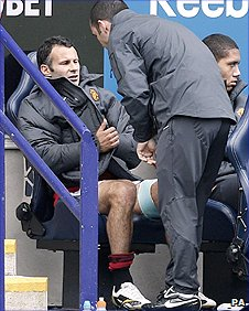 Man Utd winger Ryan Giggs (left) with strapping on his left hamstring after being substituted at Bolton