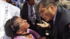 President Correa, right, speaks to a demonstrator during a protest