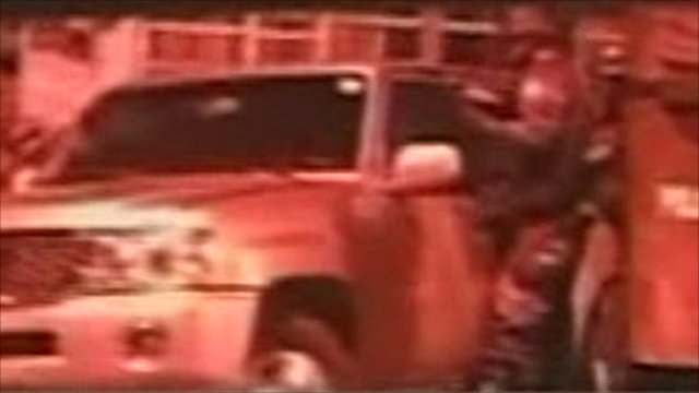 Soldier protects President Correa's car
