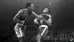 Joe Frazier hits Muhammad Ali in their heavyweight title fight in Madison Square Garden in 1971