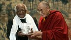 Tibet's spiritual leader the Dalai Lama giving the archbishop emeritus the Light of Truth 2006 Award for longstanding support for Tibetan culture and people, in Brussels June 2006