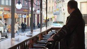 Man alone in a bar