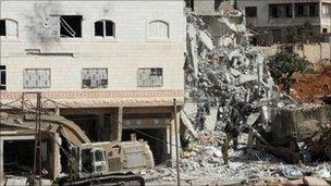 Israeli soldiers demolish a house in Hebron, 8 October