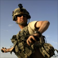 A US soldier throws a grenade in Arghandab Valley on September 11 2010