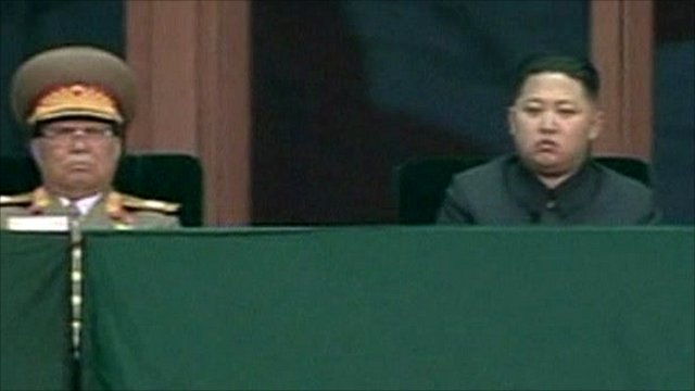 Kim Jong-un (right) on state TV