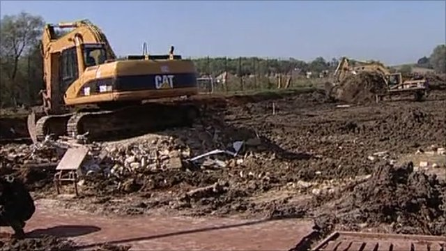 Diggers in Hungary building an emergency dam