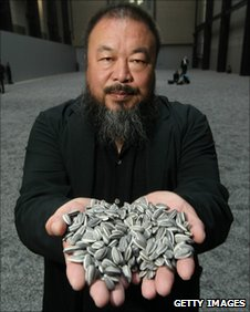 Chinese Artist Ai Weiwei holds some seeds from his installation Sunflower Seeds