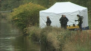 Police next to the Sheffield and South Yorkshire Navigation Canal