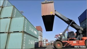 A container is unloaded from a truck at Rizhao Port in Rizhao, Shandong province