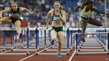 From left: New Zealand's Andrea Miller, Australia's Sally Pearson, and Jamaica's Andrea Bliss compete in the Women's 100m hurdles final during the Commonwealth Games at the Jawaharlal Nehru Stadium in New Delhi, India, Monday 11 October 2010