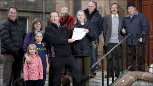 Phyllis Goodall hands over the letters of support to David Rodger of Vattenfall