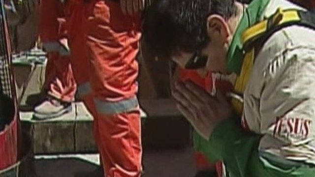 Miner Esteban Rojas prays after he is rescued