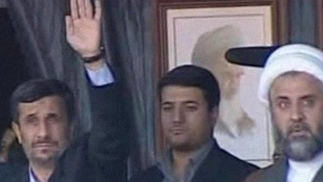 Iran's President Mahmoud Ahmadinejad ( left) waves to the crowd