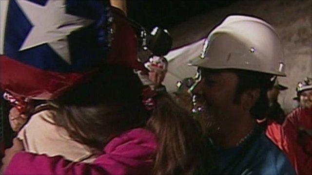 Miner hugging daughter