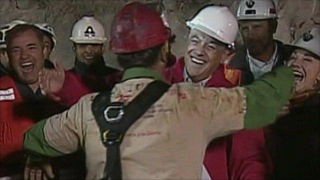 Miner embraces President Pinera
