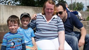 Maria Crocker with her family, including son David wearing cap