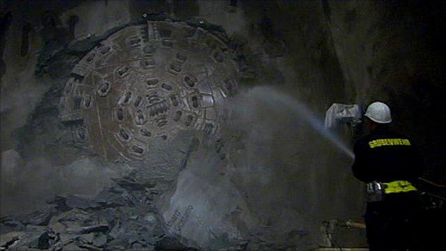 Drill breaks through rock