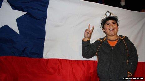A Chilean boy celebrates in Plaza Italia