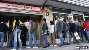People queue outside a Spanish job centre