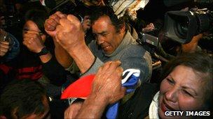 Alfonso Avalos, father of Chilean miner Florencio Avalos, celebrates