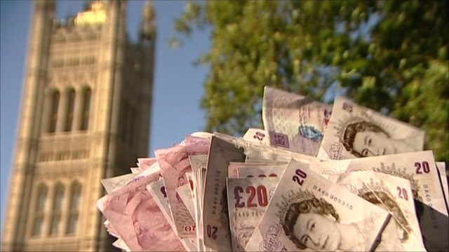 £20 notes in front of Parliament building