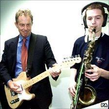 Tony Blair plays the electric guitar