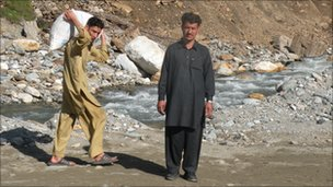 Businessman Farmanullah stands at the site where his furniture factory once stood