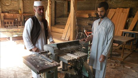 Men at work at a saw mill - one of the very few places in Shangla with a working generator